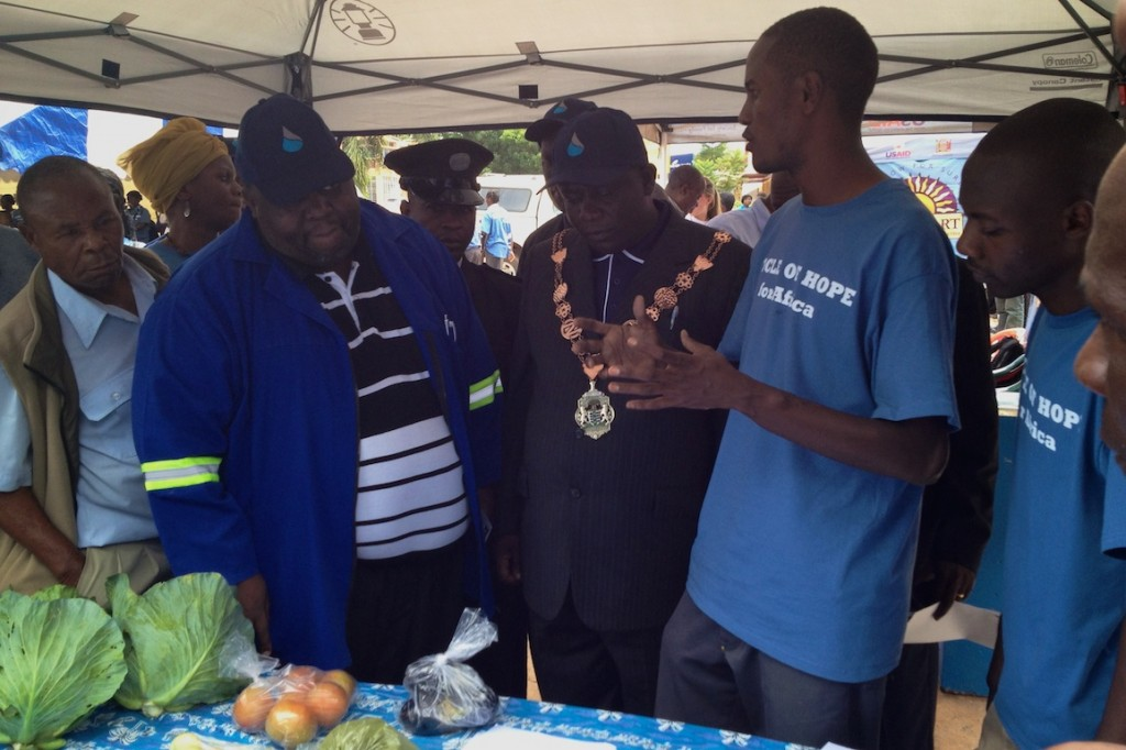 Robinson Mufumbilwa talks about Seeds of Hope's programs to the Mayor and Manager of the water company.